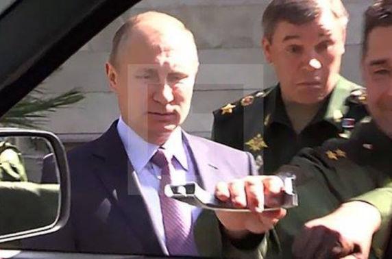 Оросын цэргийн техник нь Путины нүүрийг улалзуулав